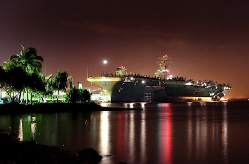 aircraft carrier docked in pearl-harbor